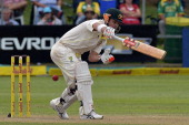 Australia's cricketer David Warner plays a shot during the second test match between South Africa and Australia at St George's Park in Port Elizabeth...