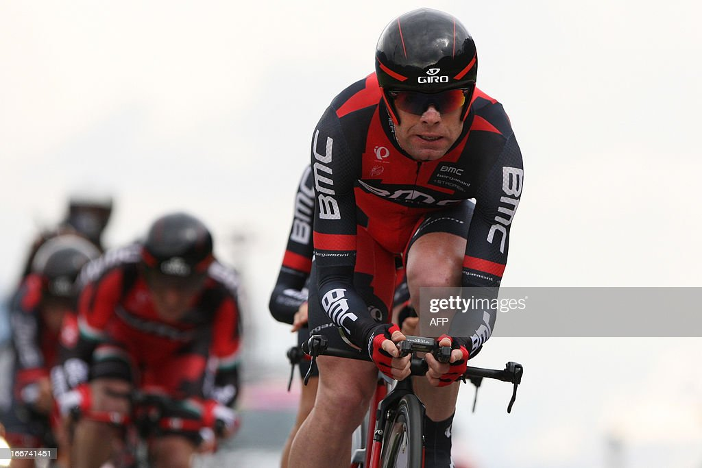 Australia's cyclist Cadel Evans (R) of BMC Racing Team ride during the Team Time Trial of 14.1 km of the cycling road race 'Giro del Trentino' in Lienz, on April 16, 2013. AFP PHOTO / PIERRE TEYSSOT