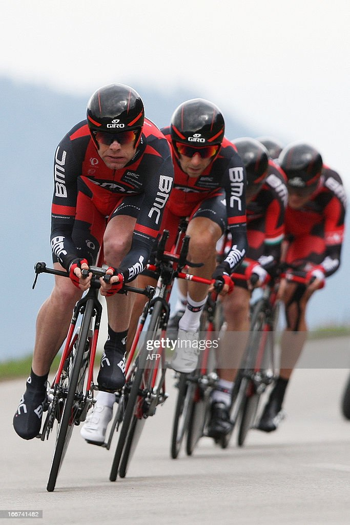 Australia's cyclist Cadel Evans (L) of BMC Racing Team ride during the Team Time Trial of 14.1 km of the cycling road race 'Giro del Trentino' in Lienz, on April 16, 2013. AFP PHOTO / PIERRE TEYSSOT