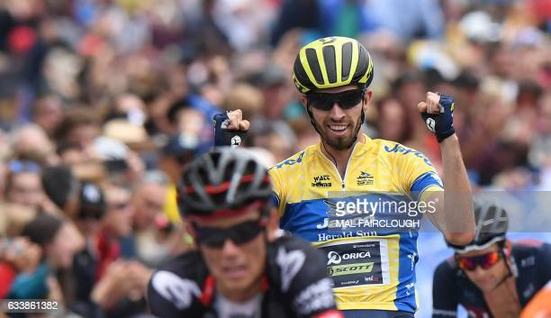 Australias Damien Howson of OricaScott raises his arms after winning the 2017 Herald Sun Tour cycling event in Melbourne on February 5 2017 / AFP /...