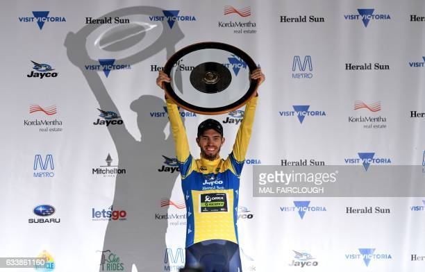 Australia's Damien Howson of OricaScott raises the trophy after winning the 2017 Herald Sun Tour cycling race in Melbourne on February 5 2017 / AFP /...