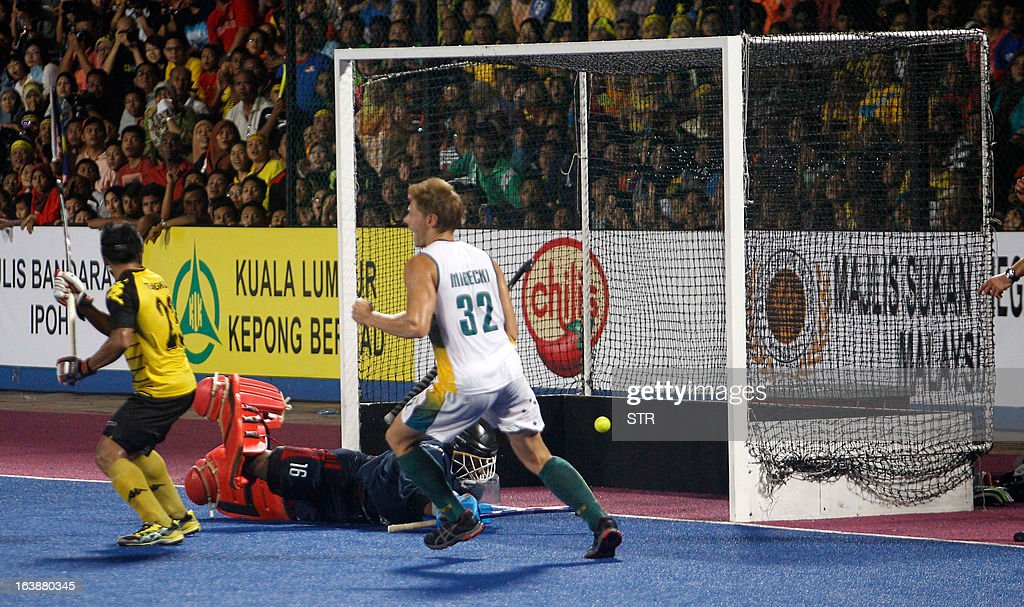 Australia's Daniel Mirecki celebrates as Malaysia's goalkeeper Kumar Subramiam fails to save a goal during the Sultan Azlan Shah Cup men's field...