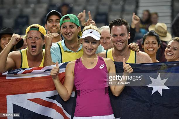 Australia's Daria Gavrilova takes a selfie with fans as she celebrates her victory against France's Kristina Mladenovic during their women's singles...