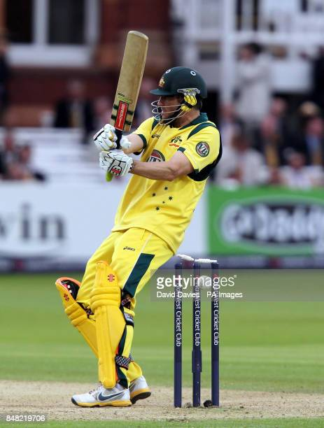Australia's David Hussey deflects the ball off his helmet on to the stumps and is out bowled by England's Steven Finn during the first One Day...