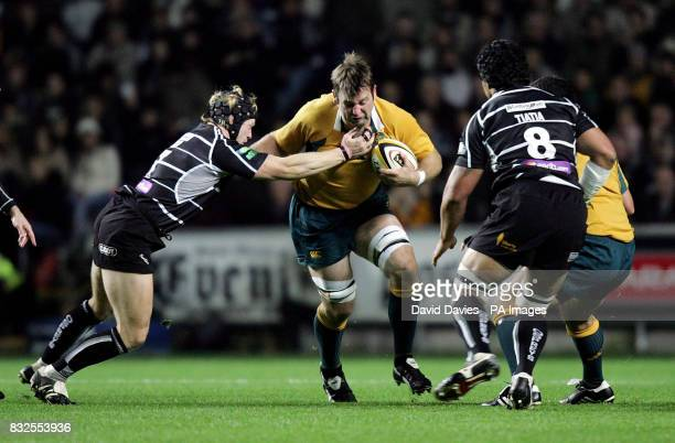 Australia's David Lyons hands off the tackle of Ospreys' Richard Pugh during the npower renewables challenge match at Liberty Stadium Swansea