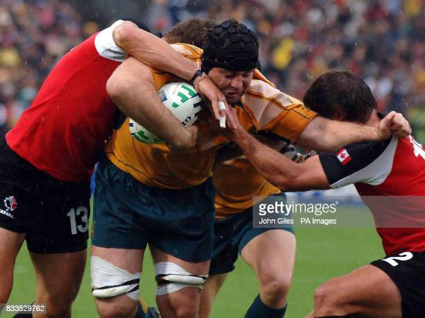 Australia's David Lyons is held up short of the line during the IRB Rugby World Cup Pool B match at Chaban Delmas Stadium Bordeaux France