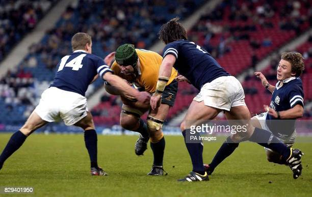 Australia's David Lyons is tackled during the International Match against Scotland at Murrayfield