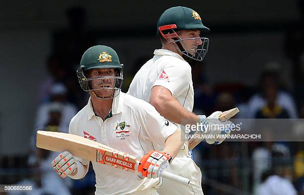Australia's David Warner and Shaun Marsh run between the wickets during the final day of the third and final Test cricket match between Sri Lanka and...