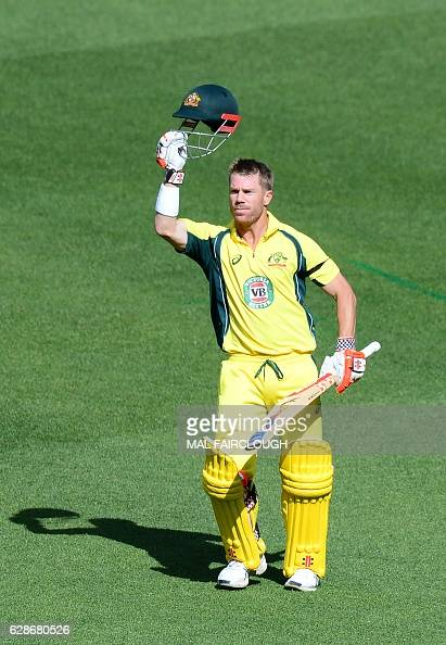 Australia's David Warner celebrates a century during the third match of the one day international cricket series between Australia and New Zealand at...
