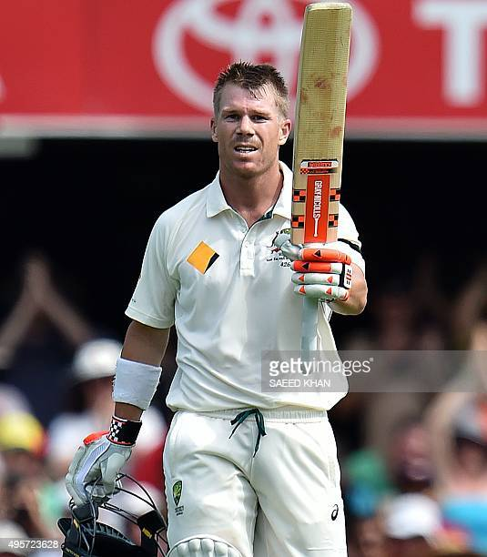 Australia's David Warner celebrates his century during day one of the first Test cricket match between Australia and New Zealand in Brisbane on...