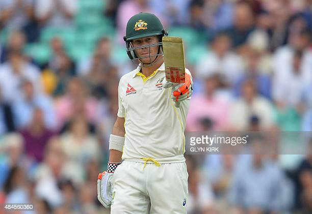 Australia's David Warner celebrates reaching fifty runs during the first day of the fifth Ashes cricket Test match between England and Australia at...