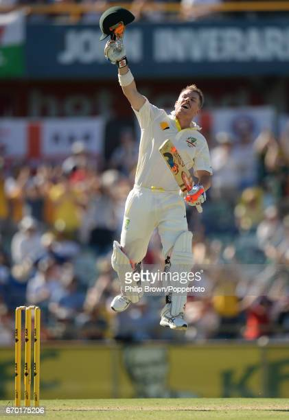 Australia's David Warner celebrates reaching his century during the 3rd Ashes cricket Test match between Australia and England at the WACA cricket...