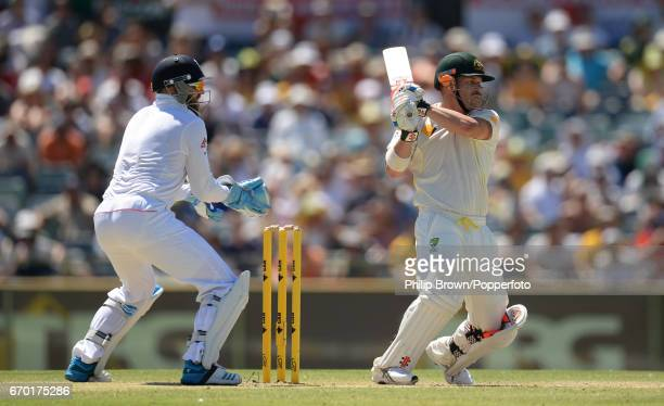 Australia's David Warner hits out watched by Matt Prior during the 3rd Ashes cricket Test match between Australia and England at the WACA cricket...