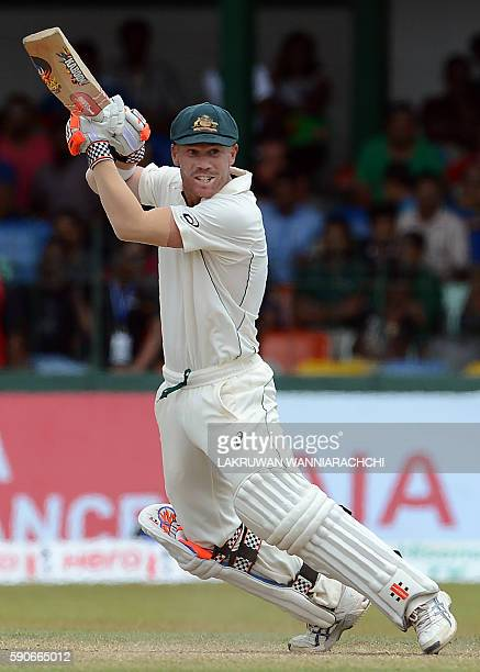 Australia's David Warner plays a shot during the final day of the third and final Test cricket match between Sri Lanka and Australia at The Sinhalese...
