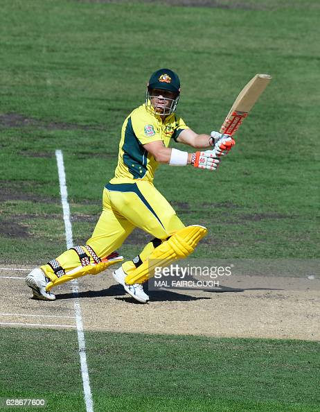 Australia's David Warner plays a shot during the third match of the one day international cricket series between Australia and New Zealand at the MCG...