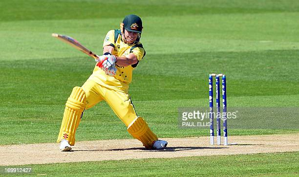 Australia's David Warner plays a shot during the warmup cricket match ahead of the 2013 ICC Champions Trophy between India and Australia at The...