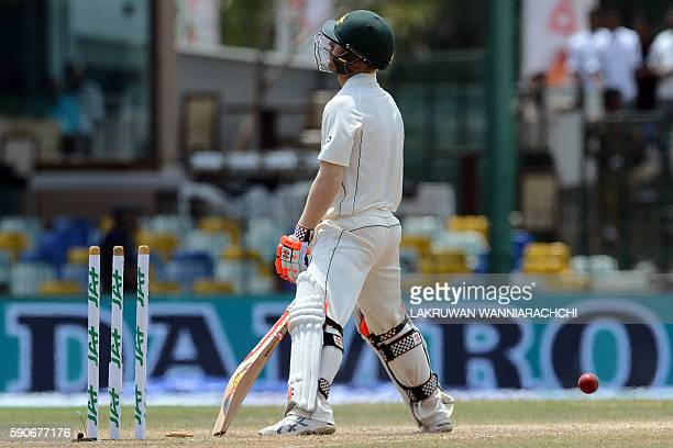 Australia's David Warner reacts after his dismissal by Sri Lanka's Dilruwan Perera during the final day of the third and final Test cricket match...