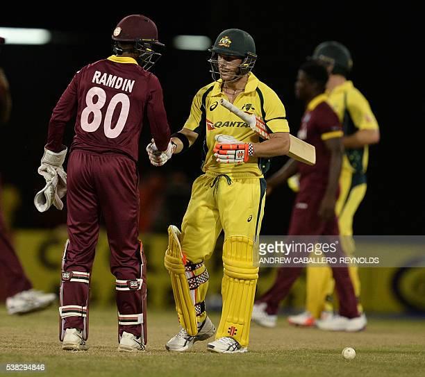 Australia's David Warner shakes hands with The West Indie's Denesh Ramdin after their Oneday International cricket match between the West Indies and...
