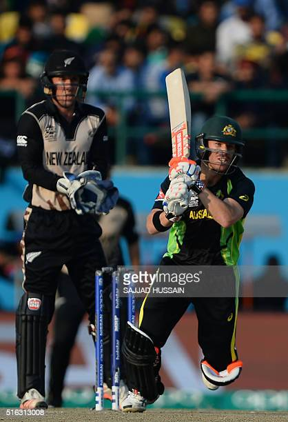 Australia's David Warneris watched by New Zealand's wicketkeeper Luke Ronchi as he plays a shot during the World T20 cricket tournament match between...