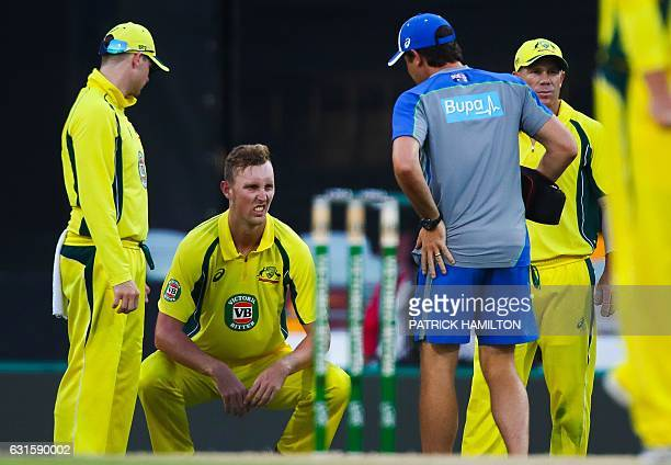 Australia's debutant bowler Billy Stanlake is attended by Australia's medical staff during the oneday international cricket match between Pakistan...