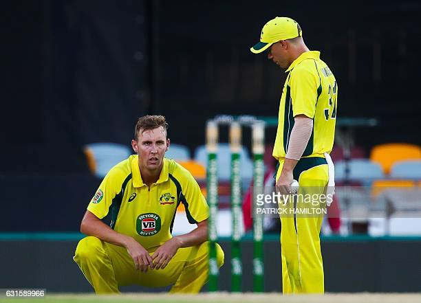 Australia's debutant bowler Billy Stanlake talks to teammate David Warner during the oneday international cricket match between Pakistan and...