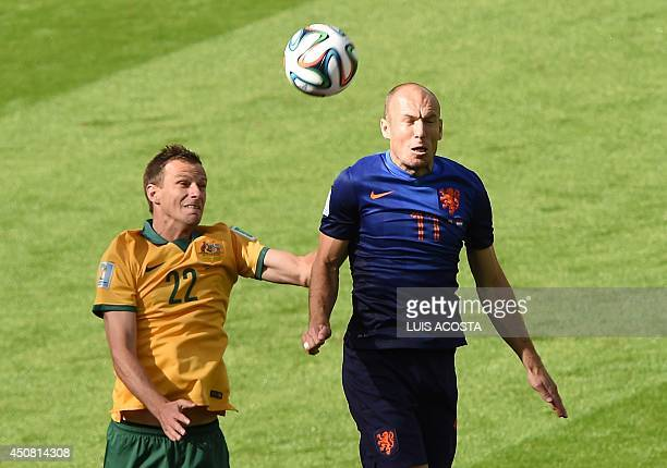 Australia's defender Alex Wilkinson vies with Netherlands' forward Arjen Robben during a Group B football match between Australia and the Netherlands...