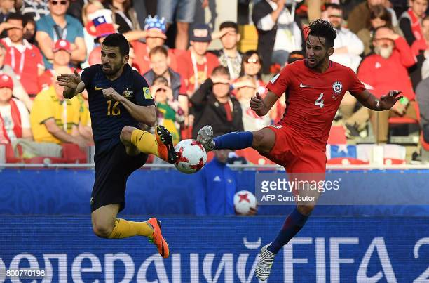 TOPSHOT Australia's defender Aziz Behich vies with Chile's defender Mauricio Isla during the 2017 Confederations Cup group B football match between...