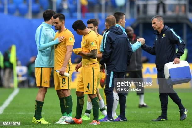 Australia's defender Bailey Wright and Australia's forward Tim Cahill leave the pitch after a 11 draw against Cameroon during the 2017 Confederations...