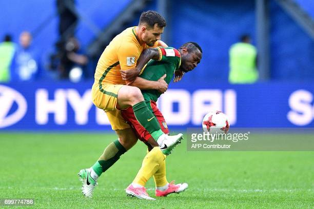 TOPSHOT Australia's defender Bailey Wright fights for the ball against Cameroon's forward Christian Bassogog during the 2017 Confederations Cup group...