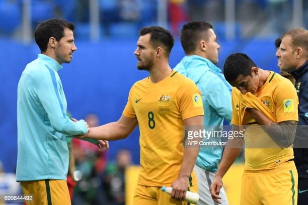 Australia's defender Bailey Wright is congratulated by a team mate at the end of the 2017 Confederations Cup group B football match between Cameroon...