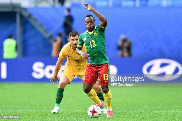 Australia's defender Bailey Wright vies for the ball against Cameroon's forward Christian Bassogog during the 2017 Confederations Cup group B...