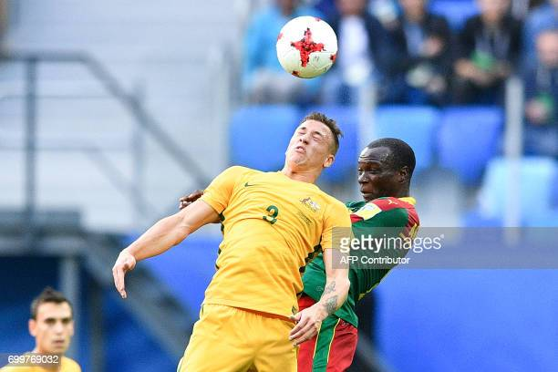 Australia's defender Bradley Smith jumps for the ball against Cameroon's forward Vincent Aboubakar during the 2017 Confederations Cup group B...