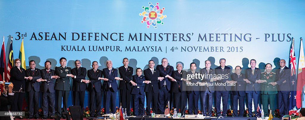 Australia's Defense Minister Marise Payne, Brunei's Defense Minister Mohammad Yasmin Umar, Cambodia's Defense Minister Gen. Tea Banh, China's Defense Minister Chang Wanquan, India's Defense Minister Manohar Parrikar, Indonesia's Defense Minister <a gi-track='captionPersonalityLinkClicked' href=/galleries/search?phrase=Ryamizard+Ryacudu&family=editorial&specificpeople=2747233 ng-click='$event.stopPropagation()'>Ryamizard Ryacudu</a>, Japan's Defense Minister <a gi-track='captionPersonalityLinkClicked' href=/galleries/search?phrase=Gen+Nakatani&family=editorial&specificpeople=2676983 ng-click='$event.stopPropagation()'>Gen Nakatani</a>, Myanmar's Defense Minister Sein Win, Laos' Defense Minister Sengnouane Sayalat, Malaysia's Defense Minister Hishamuddin Hussein, New Zealand's Defense Minister Gerry Brownlee, Philippines' Secretary of Defense Voltaire Gazmin, South Korea's Defense Minister Han Min Koo, Russia's Deputy Defense Minister Anatoly Antonov, Singapore's Defense Minister Ng Eng Hen, Thailand's Defense Minister Gen. Prawit Wongsuwon, U.S. Defense Secretary Ash Carter and Vietnam's Deputy Defense Minister Nguyen Van Hein join hands as they pose for photographers after the ASEAN defence ministers meeting plus 2015 on November 4, 2015 in Kuala Lumpur, Malaysia. Asean face pressure to back China on the South China Sea issue, while the US and Japan are pushing to get concerns about the dispute included in a statement to be issued after regional defence talks.