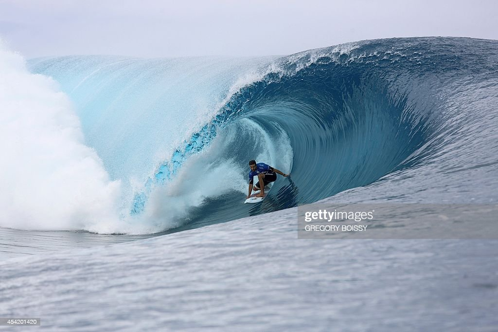 Australia's Dion Atkinson rides a wave during the finale of the 14th edition of the Billabong Pro Tahiti surf event, part of the ASP (Association of Surfing Professionals) world tour, on August 25, 2014 in Teahupoo, on the French Polynesian island of Tahiti. Brazil's Gabriel Medina won over US Kelly Slater.