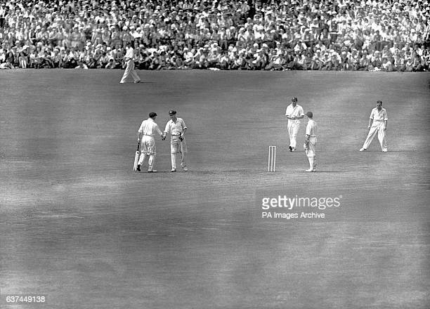 Australia's Don Bradman congratulates teammate Arthur Morris on reaching his century during their second wicket stand of 301 Australia set a new test...