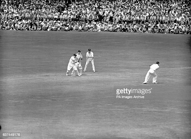 Australia's Don Bradman pulls the ball to the boundary for another four runs during his unbeaten matchwinning innings of 173 watched by England...
