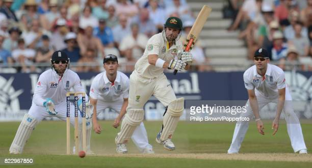 Australia's Ed Cowan hits out watched by England fielers Matt Prior Jonathan Trott and James Anderson during the 1st Test match between England and...