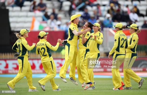 Australia's Elyse Villani celebrates the wicket of India's Smriti Mandhana with teammates during the ICC Women's World Cup Semi Final match at The...