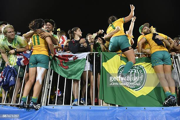 Australia's Emilee Cherry and Australia's Shannon Parry celebrate with supporters after winning the womens rugby sevens gold medal match between New...