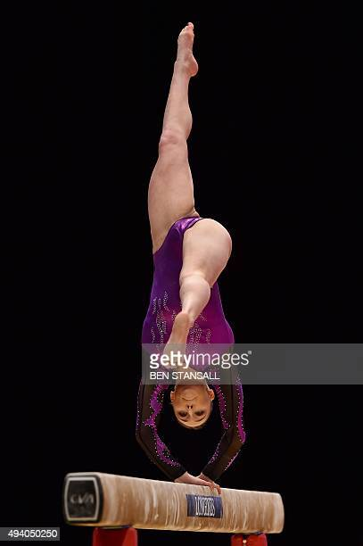 Australia's Emily Little competes on the beam during the second day of the 2015 World Gymnastics Championship in Glasgow Scotland on October 24 2015...