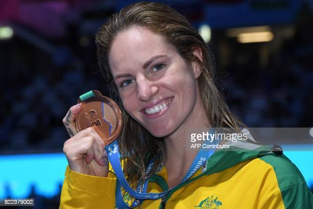 Australia's Emily Seebohm celebrates on the podium after the women's 100m backstroke final during the swimming competition at the 2017 FINA World...
