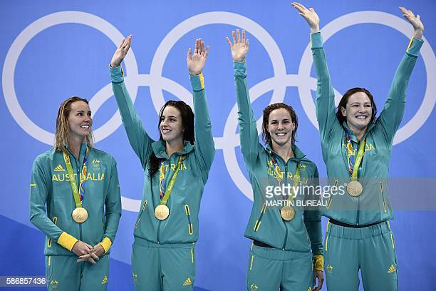 Australia's Emma Mckeon Australia's Brittany Elmslie Australia's Bronte Campbell and Australia's Cate Campbell pose on the podium with their gold...