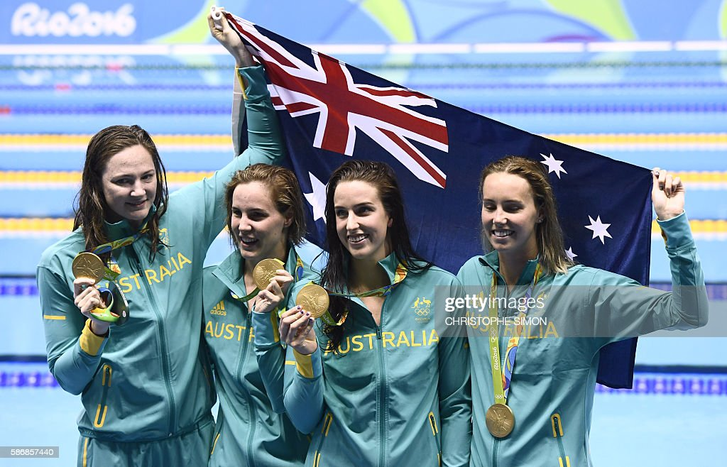 Australia's Emma Mckeon, Australia's Brittany Elmslie, Australia's Bronte Campbell and Australia's Cate Campbell pose with their gold medals on the podium after they broke the world in the Women's 4 x 100m Freestyle Relay Final during the swimming event at the Rio 2016 Olympic Games at the Olympic Aquatics Stadium in Rio de Janeiro on August 6, 2016. / AFP / CHRISTOPHE