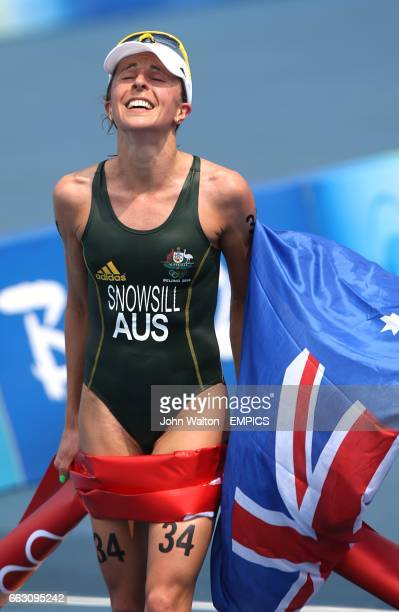 Australia's Emma Snowsill celebrates wining the Women's Triathlon at the Ming Tomb Reservoir in Changping District of northern Beijing on day 10 of...