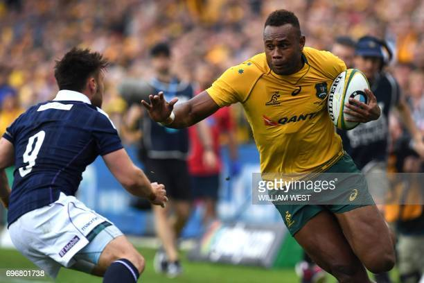 Australia's Eto Nabuli is tackled by Scotland's Ali Price during their rugby union Test match in Sydney on June 17 2017 / AFP PHOTO / William WEST /...