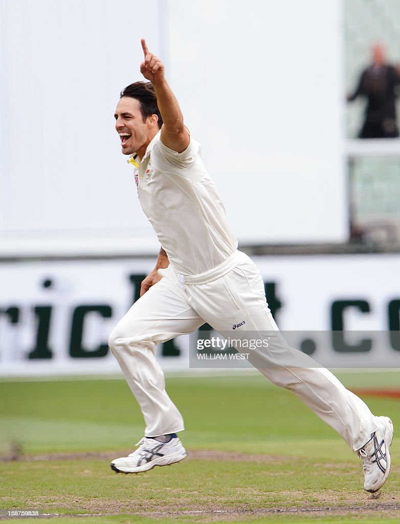 Australia's fast bowler Mitchell Johnson celebrates after dismissing Sri Lanka's batsman Tillakaratne Dilshan on the third day of the second cricket Test match at the Melbourne Cricket Ground (MCG) on December 28, 2012. AFP PHOTO/William WEST USE