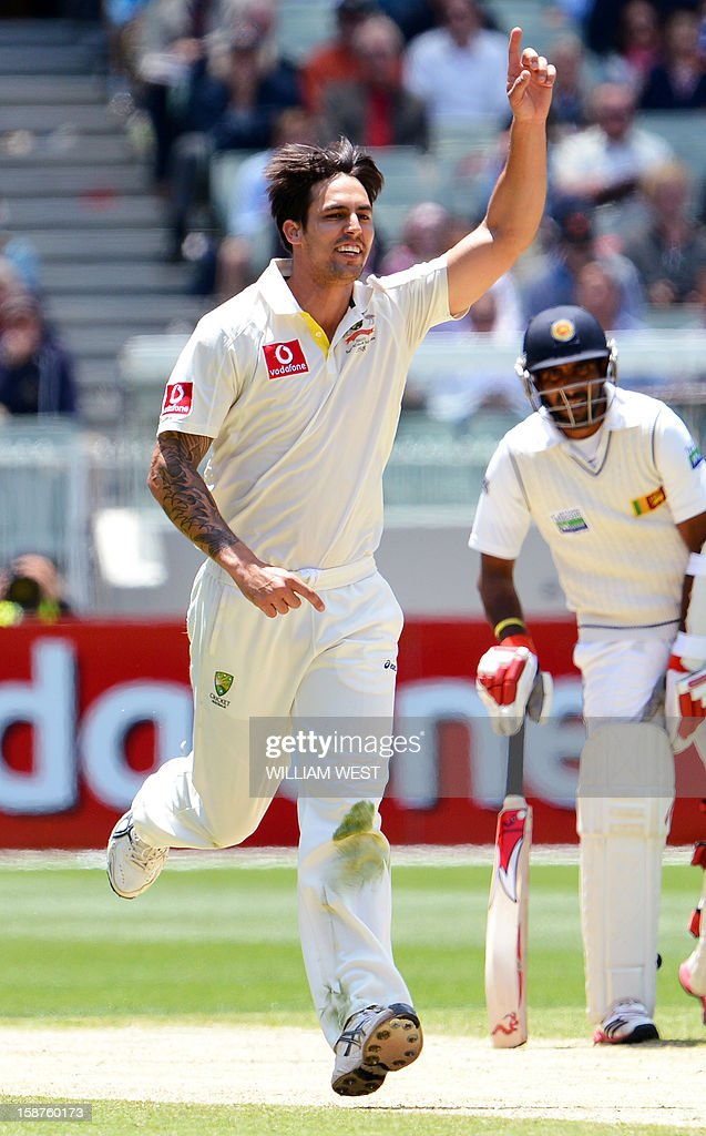 Australia's fast bowler Mitchell Johnson celebrates dismissing Sri Lanka's batsman Angelo Mathews on the third day of the second cricket Test match at the Melbourne Cricket Ground (MCG) on December 28, 2012. AFP PHOTO/William WEST USE