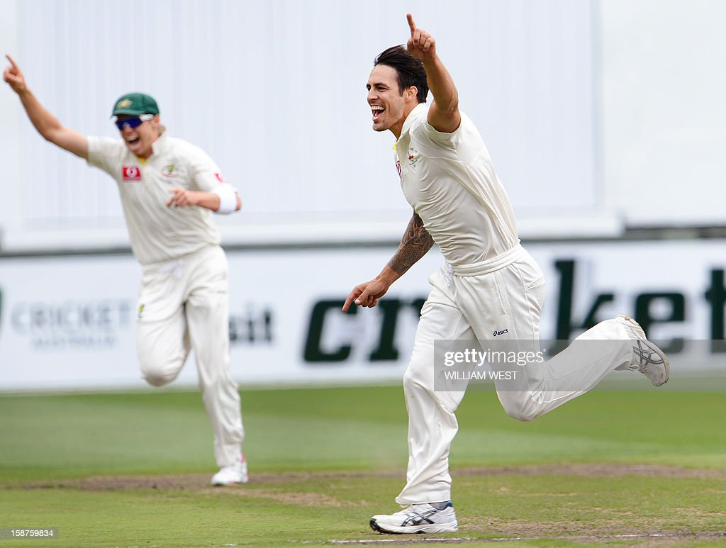 Australia's fast bowler Mitchell Johnson (R) celebrates with teammate Peter Siddle (L) after dismissing Sri Lanka's batsman Tillakaratne Dilshan on the third day of the second cricket Test match at the Melbourne Cricket Ground (MCG) on December 28, 2012. AFP PHOTO/William WEST USE