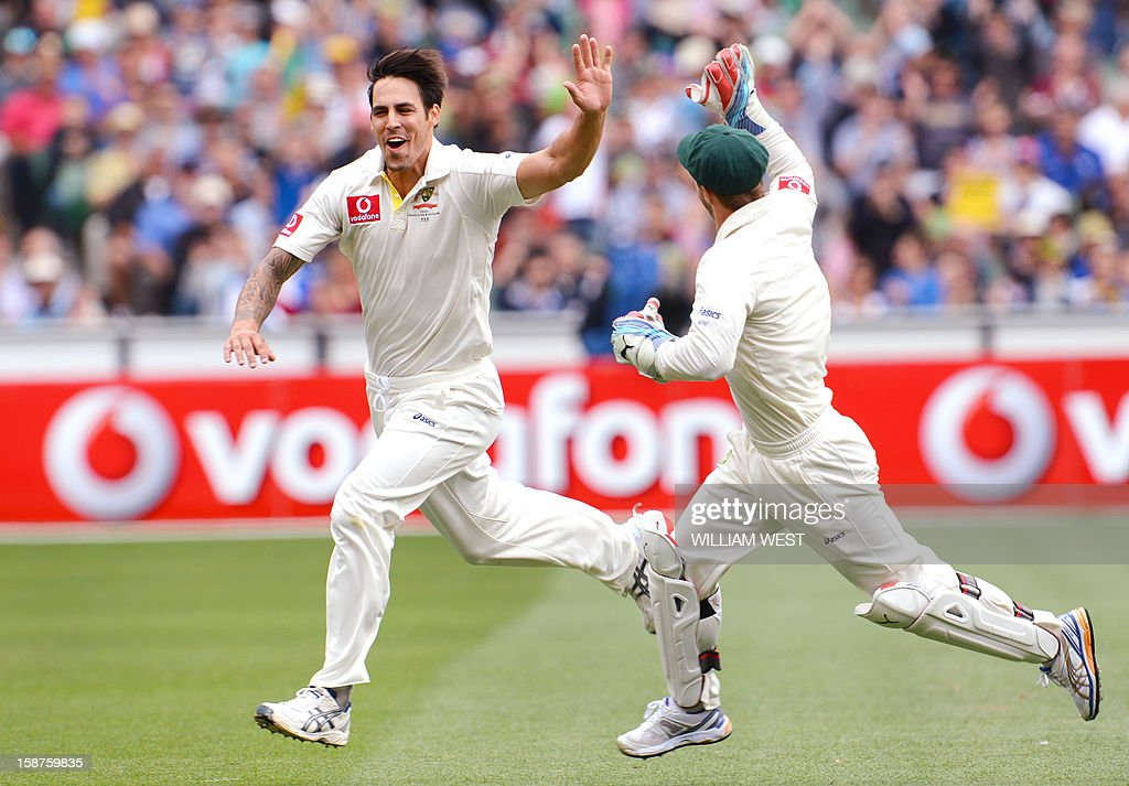 Australia's fast bowler Mitchell Johnson (L) celebrates with wicketkeeper Matthew Wade (R) after dismissing Sri Lanka's batsman Tillakaratne Dilshan on the third day of the second cricket Test match at the Melbourne Cricket Ground (MCG) on December 28, 2012. AFP PHOTO/William WEST USE
