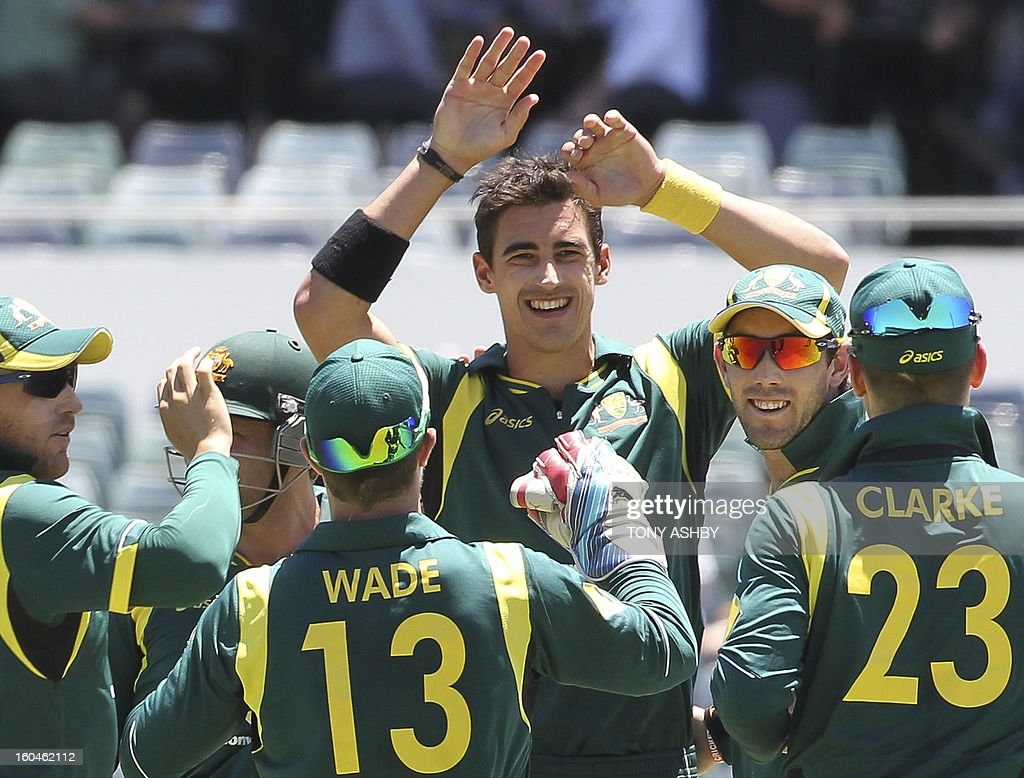 Australia's fast bowler Mitchell Starc (C) celebrates taking one of his five wickets for 20 runs during the one-day international cricket match between Australia and the West Indies at the WACA ground on February 1, 2013. AFP PHOTO/Tony ASHBY USE